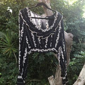 Free people long sleeve crop top . Has mtch skirt